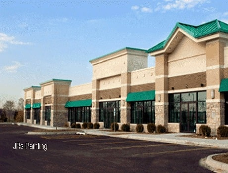 commercial painting contractors in overland park painting a building