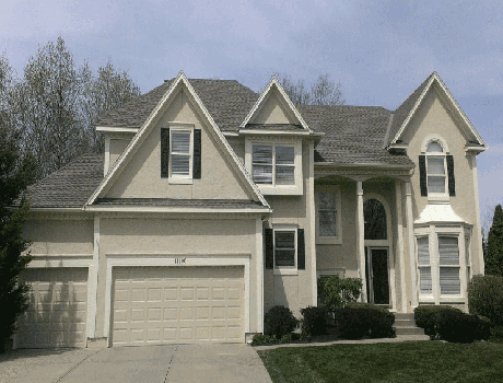 exterior house painters in overland park ks painting a house