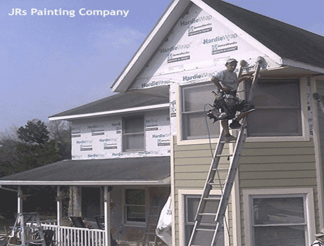 wood siding repair company in kansas city making wood rot repairs on a house